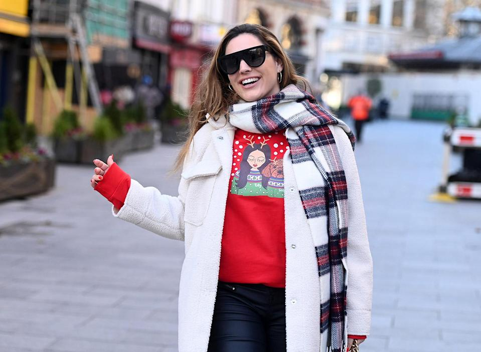 <p>Kelly Brook shows off her personalized Christmas sweater as she arrives at Global Radio studios in London to record her Heart FM show.</p>