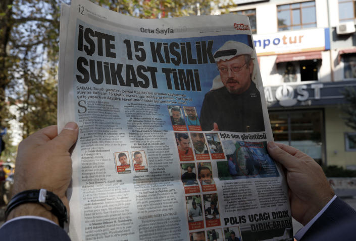 """A man reads the Sabah newspaper, with a headline that reads """"15-member assassination squad """" in Ankara, Turkey, Wednesday, Oct. 10, 2018. Sabah on Wednesday revealed the identities of what it called a """"mysterious"""" 15-member """"assassination squad"""" who were allegedly involved in Saudi writer and government critic Jamal Khashoggi's disappearance inside his country's consulate in Istanbul. (AP Photo/Burhan Ozbilici)"""
