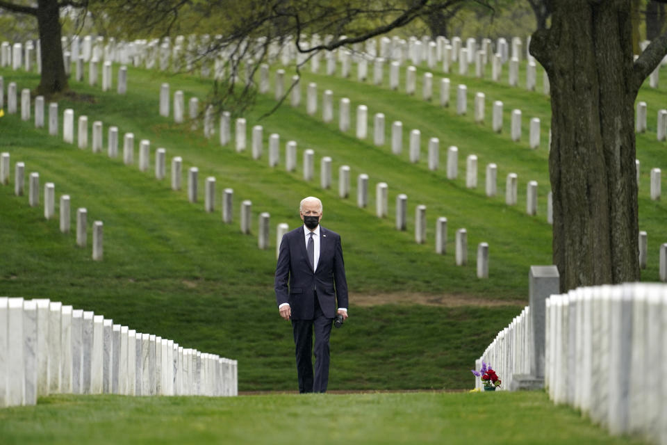 FILE - In this April 14, 2021, file photo President Joe Biden visits Section 60 of Arlington National Cemetery in Arlington, Va. The need for crisis-driven leadership comes to all U.S. presidents. Now, on several fronts at once, it has come to President Joe Biden. As the president who is ending America's longest war, in Afghanistan, he will be judged by history for how he did it. (AP Photo/Andrew Harnik, File)