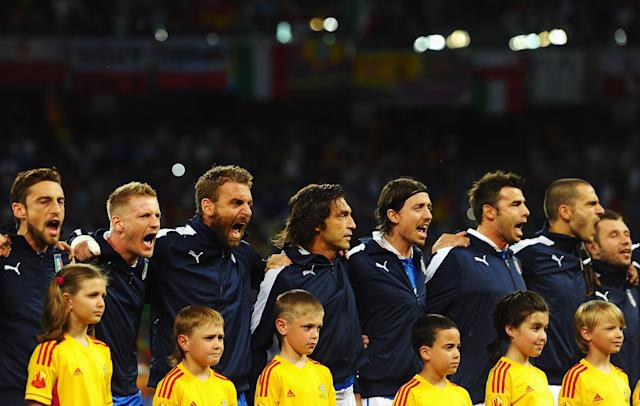 KIEV, UKRAINE - JULY 01: Italy players sing the national anthem before the UEFA EURO 2012 final match between Spain and Italy at the Olympic Stadium on July 1, 2012 in Kiev, Ukraine. (Photo by Laurence Griffiths/Getty Images)