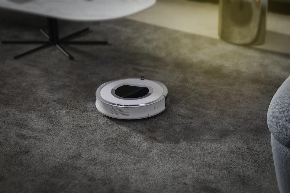 Robots vacuums cleaners on carpet in living room for cleaning pet hair and dust.
