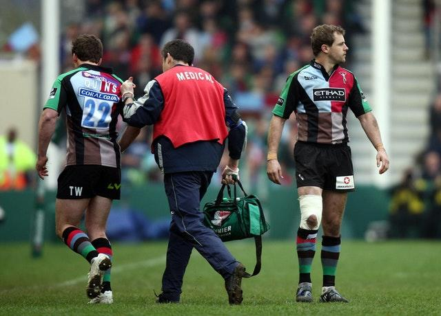 Harlequins Tom Williams, left, is blood replaced by Nick Evans in the last few minutes of the Heineken Cup match at Twickenham Stoop against Leinster