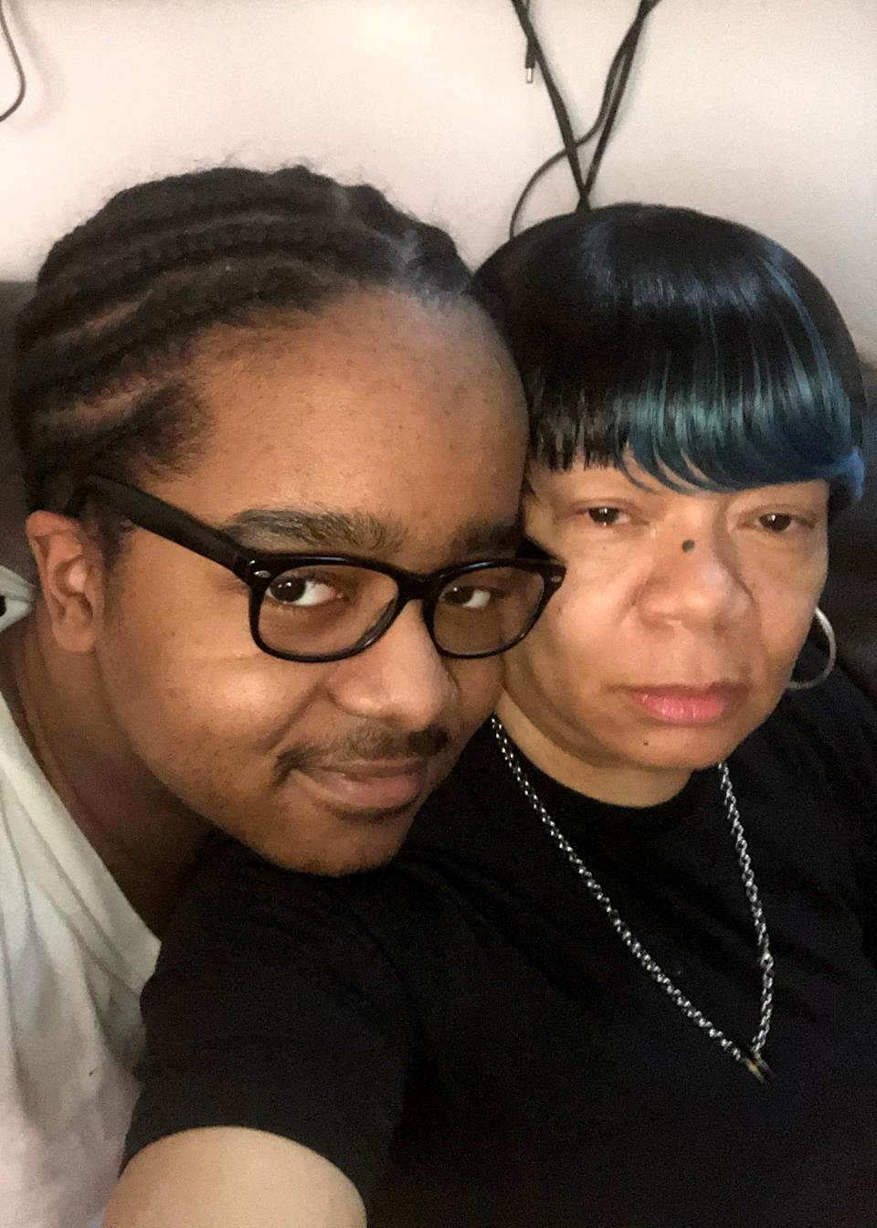 Image: Winston Brown, 15, and his mother, Gilian Mcleish. He was banished to virtual instruction at his charter school in Philadelphia. (Family Handout)