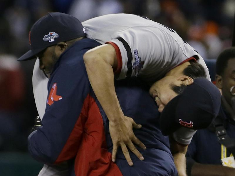 Boston Red Sox's David Ortiz picks up Koji Uehara after the Red Sox defeating the Detroit Tigers 4-3 in Game 5 of the American League baseball championship series Thursday, Oct. 17, 2013, in Detroit. (AP Photo/Matt Slocum)