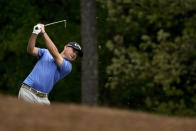 Brian Harman hits from the fairway on the 11th hole during the second round of the Masters golf tournament on Friday, April 9, 2021, in Augusta, Ga. (AP Photo/Charlie Riedel)