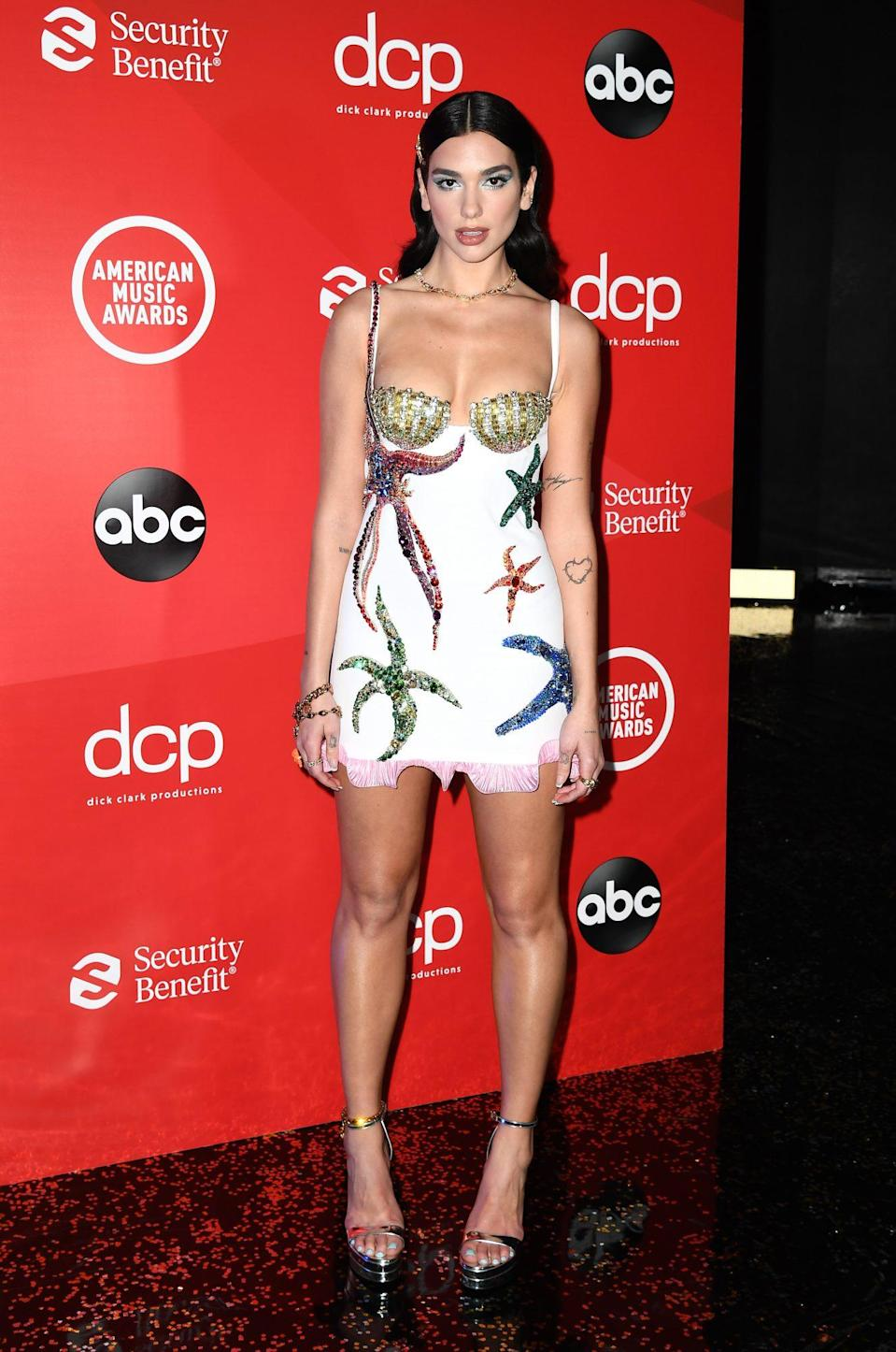 <p>A Versace mermaid moment. Dua Lipa wore an under-the-sea micro-mini from Donatella and Co. She arrived at Royal Albert Hall in London, where she'll be performing.</p>