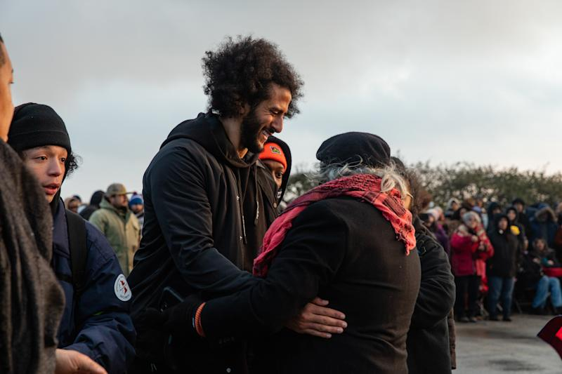 Colin Kaepernick, former quarterback for the 49ers and political activist, greets attendees.
