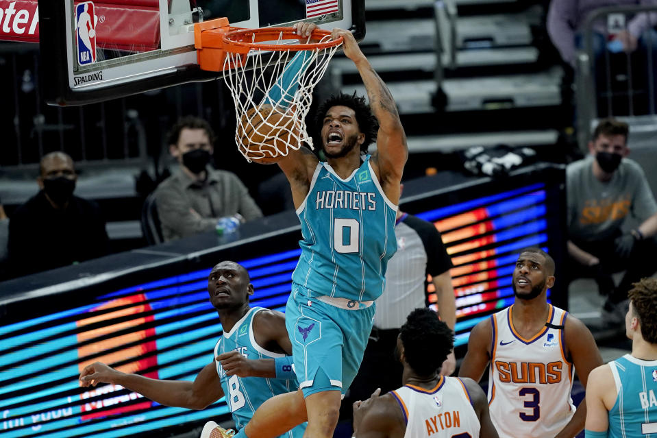 Charlotte Hornets forward Miles Bridges (0) dunks against the Phoenix Suns during the second half of an NBA basketball game, Wednesday, Feb. 24, 2021, in Phoenix. (AP Photo/Matt York)