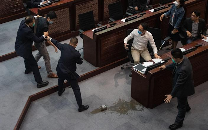 Three former pro-democracy lawmakers, including Eddie Chu Hoi-dick, Ted Hui Chi-fung and Raymond Chan, were arrested on 18 November, in connection with their attempts to disrupt the passage of the national anthem bill, at the Legislative Council, earlier this year.