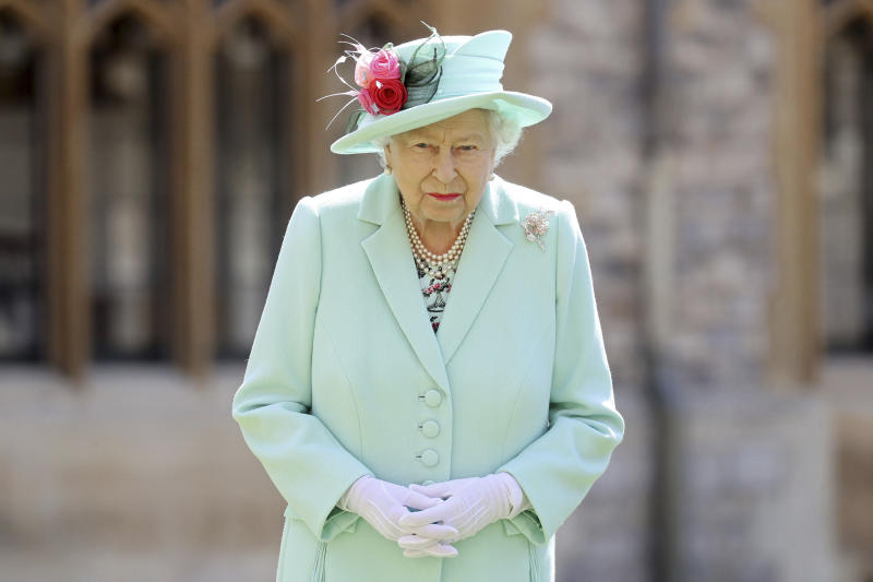 Britain's Queen Elizabeth looks on after awarding Captain Sir Thomas Moore his knighthood during a ceremony at Windsor Castle in Windsor, England, Friday, July 17, 2020. Captain Sir Tom raised almost £33 million for health service charities by walking laps of his Bedfordshire garden. (Chris Jackson/Pool Photo via AP)