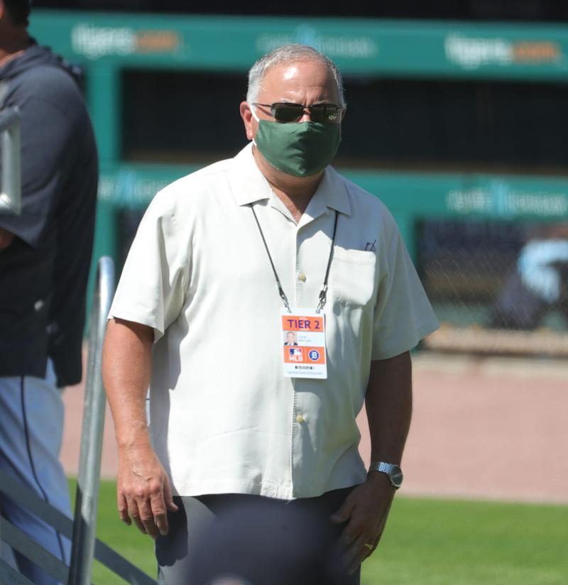 Detroit Tigers general manager Al Avila joins the team on the field at Comerica Park on the first day of workouts during the reboot of training camp.