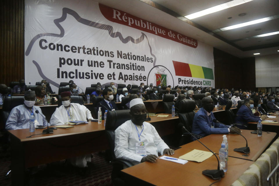 Ambassadors and foreign representations, wait for meeting with Military junta led by Col. Mamady Doumbouya, at the peoples palace in Conakry, Guinea Wednesday, Sept. 15, 2021. Guinea's junta is expected to face more pressure to set a timeframe for new elections Tuesday as the military rulers open a four-day series of meetings about the West African nation's future following the president's overthrow in a coup just over a week ago. (AP Photo/Sunday Alamba)