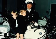 <p>The prince salutes on a motorbike with his big brother William while visiting the police force in Windsor. <br></p>