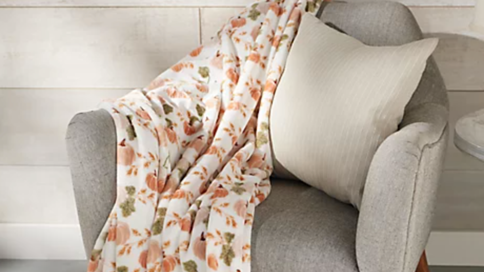 Cozy up with a festive throw blanket for the season.