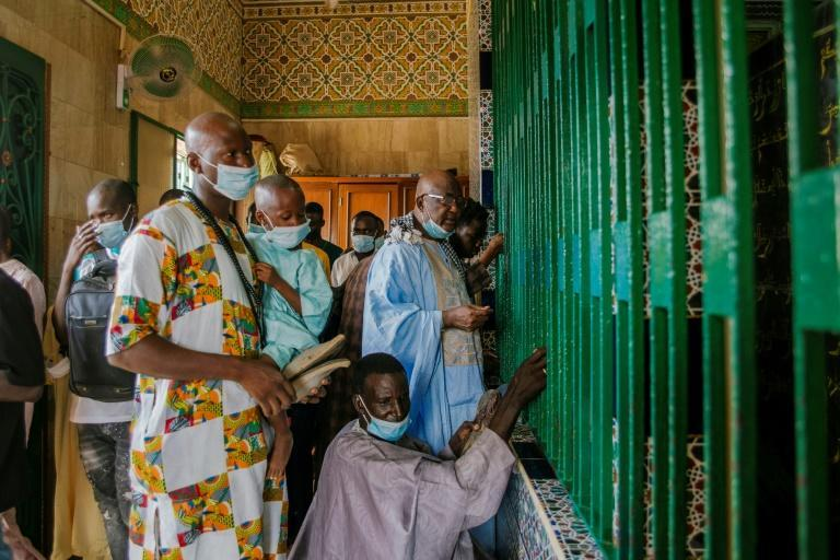 Worshippers cannot enter the mosque without a mask (AFP/CARMEN ABD ALI)