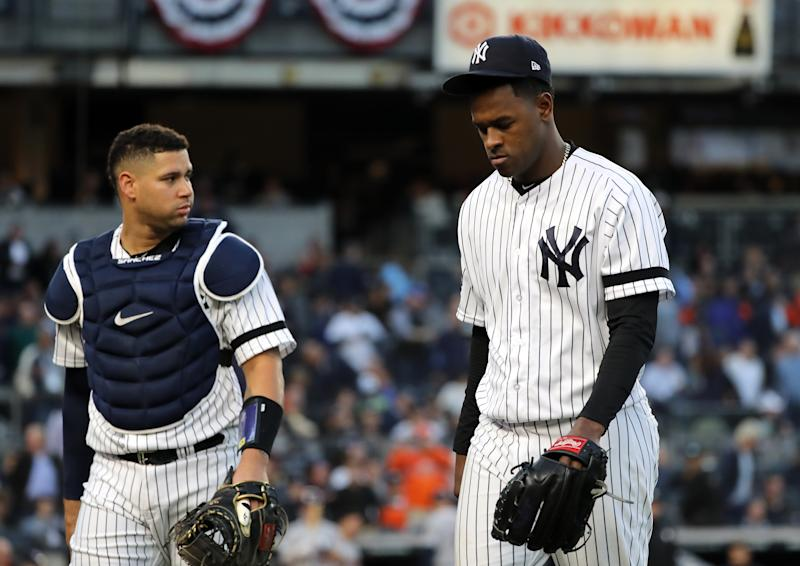 NEW YORK, NEW YORK - OCTOBER 15: Luis Severino #40 and Gary Sanchez #24 of the New York Yankees walk to the dugout prior to the fifth inning as the home plate umpire is replaced in game three of the American League Championship Series at Yankee Stadium on October 15, 2019 in New York City. (Photo by Elsa/Getty Images)