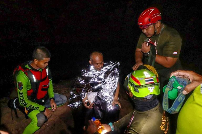 Rescue divers have freed a meditating Buddhist monk from a flooded cave in Thailand