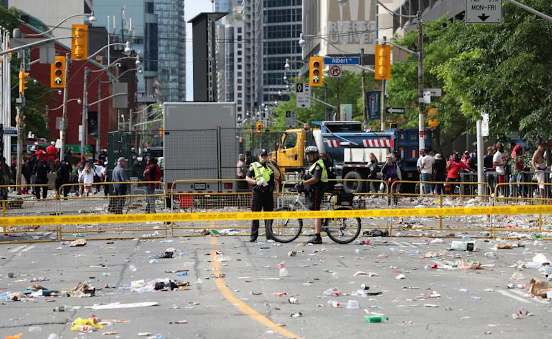 Police monitor a cordoned off area in the city. Source: Getty