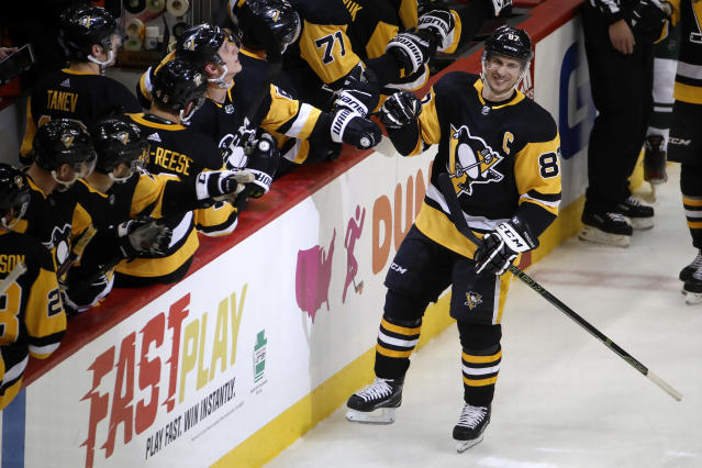Pittsburgh Penguins' Sidney Crosby (87) returns to the bench after his goal during the third period of an NHL hockey game against the Minnesota Wild in Pittsburgh, Tuesday, Jan. 14, 2020. (AP Photo/Gene J. Puskar)