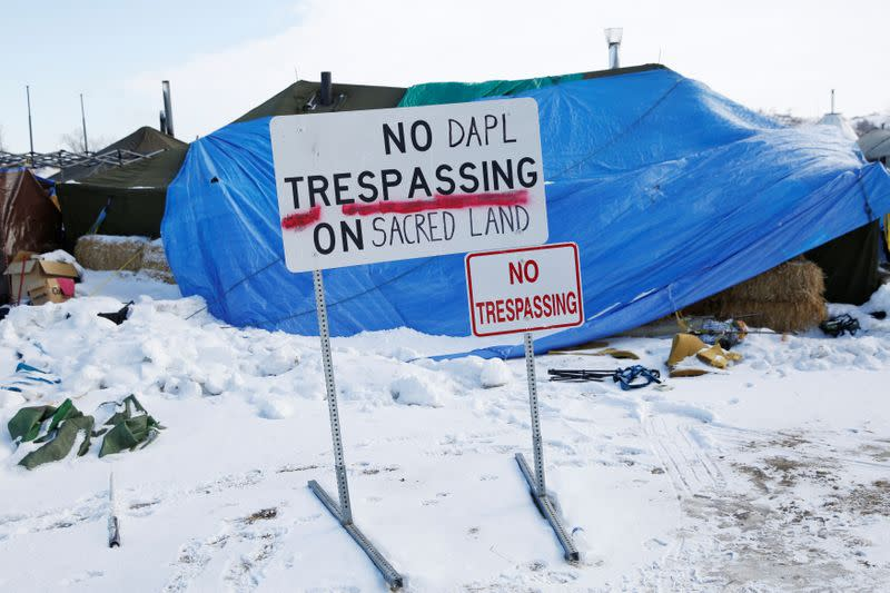 """A modified """"No Trespassing"""" sign is seen in the opposition camp against the Dakota Access oil pipeline (DAPL) near Cannon Ball"""