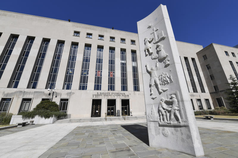 FILE - In this Oct. 11, 2019 file photo, a view of the E. Barrett Prettyman United States Courthouse in Washington.  A federal judge in the District of Columbia has temporarily halted the first federal execution in 16 years as a lawsuit on how the government intends to carry it out continues. (AP Photo/Susan Walsh)