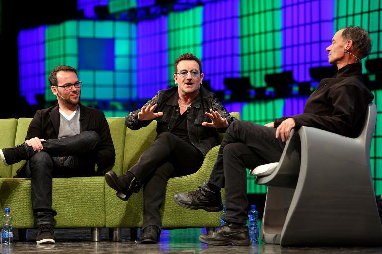 U2 frontman Bono (C) speaks on centre stage during the last day of the Web Summit in Dublin, Ireland, on November 6, 2014