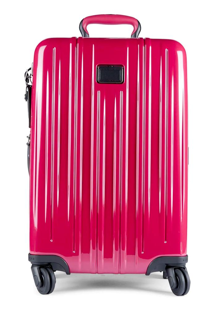 """<p><strong>Tumi</strong></p><p>saksoff5th.com</p><p><strong>$339.99</strong></p><p><a href=""""https://go.redirectingat.com?id=74968X1596630&url=https%3A%2F%2Fwww.saksoff5th.com%2Fproduct%2Ftumi-international-22-inch-expandable-suitcase-0400013204440.html%3Fdwvar_0400013204440_color%3DRASPBERRY&sref=https%3A%2F%2Fwww.cosmopolitan.com%2Fstyle-beauty%2Ffashion%2Fg35681726%2Fexpensive-items-on-sale-hauliday%2F"""" rel=""""nofollow noopener"""" target=""""_blank"""" data-ylk=""""slk:Shop Now"""" class=""""link rapid-noclick-resp"""">Shop Now</a></p>"""
