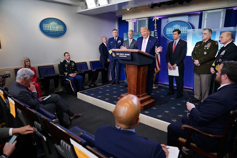 Conselor to the president Kellyanne Conway (L) watches US President Donald Trump talk flanked by (L-R) Coast guards admiral Karl Schultz, National Security Advisor Robert O'Brien, US Attorney General William Barr (hidden), US Defense Secretary Mark Esper, Chairman of the Joint Chiefs of Staff Gen. Mark Milley and Chief of Naval Operations Admiral Michael Gilday during the daily briefing on the novel coronavirus, COVID-19, in the Brady Briefing Room at the White House on April 1, 2020, in Washington, DC. (Photo by MANDEL NGAN / AFP) (Photo by MANDEL NGAN/AFP via Getty Images)