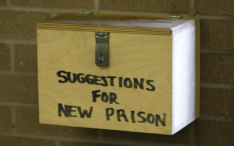 In this Monday, Nov. 18, 2013 photo, a suggestion box hangs on a wall in the kitchen at the Iowa State Penitentiary in Fort Madison, Iowa. The penitentiary, the oldest in use west of the Mississippi River with a history dating back to 1839, is set to close when a $130 million replacement opens down the road next year. (AP Photo/Charlie Neibergall)