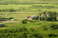 A view of the site where ground-penetrating radar recorded hits of what are believed to be 751 unmarked graves near the grounds of the former Marieval Indian Residential School on the Cowessess First Nation, Saskatchewan, Saturday, June 26, 2021. (Mark Taylor/The Canadian Press via AP)