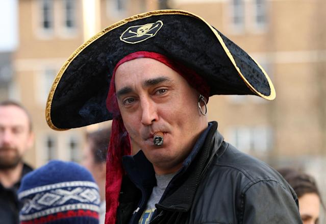 LONDON, UNITED KINGDOM - APRIL 08: A smoking a cigar and wearing a pirate's hat joins others as they celebrate the death of former British Prime Minister Margaret Thatcher in Brixton on April 8, 2013 in London, England. Lady Thatcher has died this morning following a stroke aged 87. Margaret Thatcher was the first female British Prime Minster and governed the UK from 1979 to 1990. She led the UK through some turbulent years and contentious issues including the Falklands War, the miners' strike and the Poll Tax riots. (Photo by Danny E. Martindale/Getty Images)
