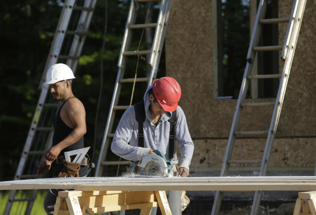 "Carpenters cut fascia trimwork at a housing site at Mid-Atlantic Builders ""The Villages of Savannah"" development in Brandywine, Maryland May 31, 2013. REUTERS/Gary Cameron"