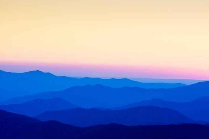 <p>Sunset at the Great Smoky Mountains National Park's Clingman's Dome is a great time to see how these famed mountains got their name.</p>