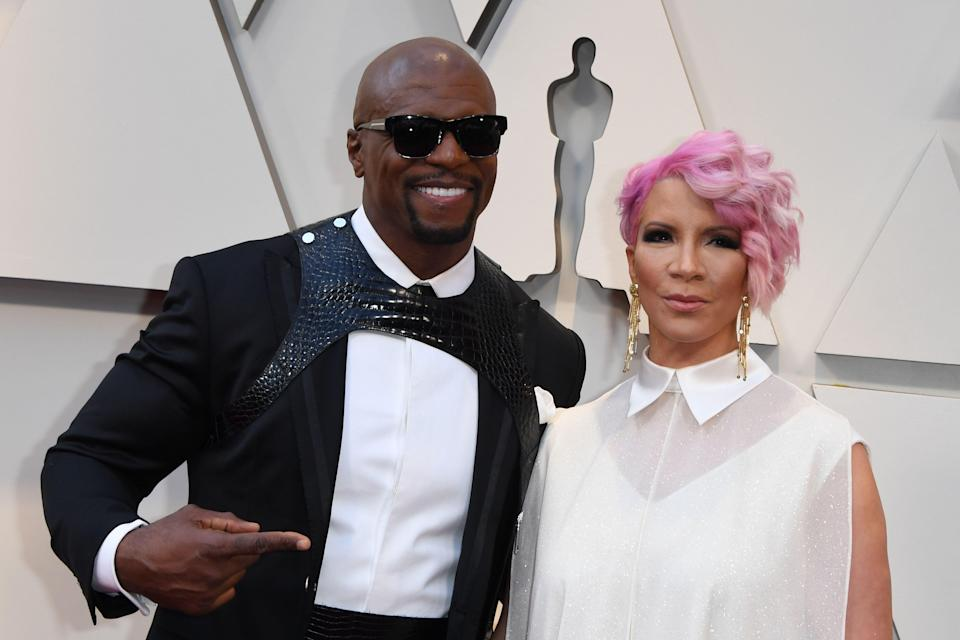 Terry Crews with his wife, Rebecca King-Crews. (Mark Ralston/AFP via Getty Images)