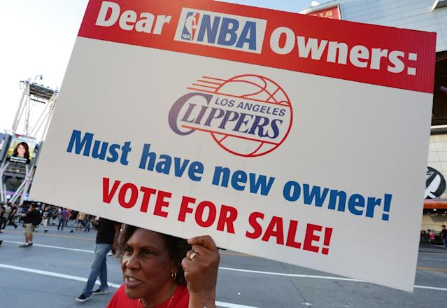 LOS ANGELES, CA - APRIL 29: Susan Wright holds a sign protesting racist comments made by L.A. Clippers owner Donald Sterling outside Staples Center before a playoff game on April 29, 2014 in Los Angeles, California. Clippers owner Donald Sterling was banned for life today by the NBA and barred from having any association with the team and ordered to pay a $2.5 million fine. (Photo by Jonathan Alcorn/Getty Images)