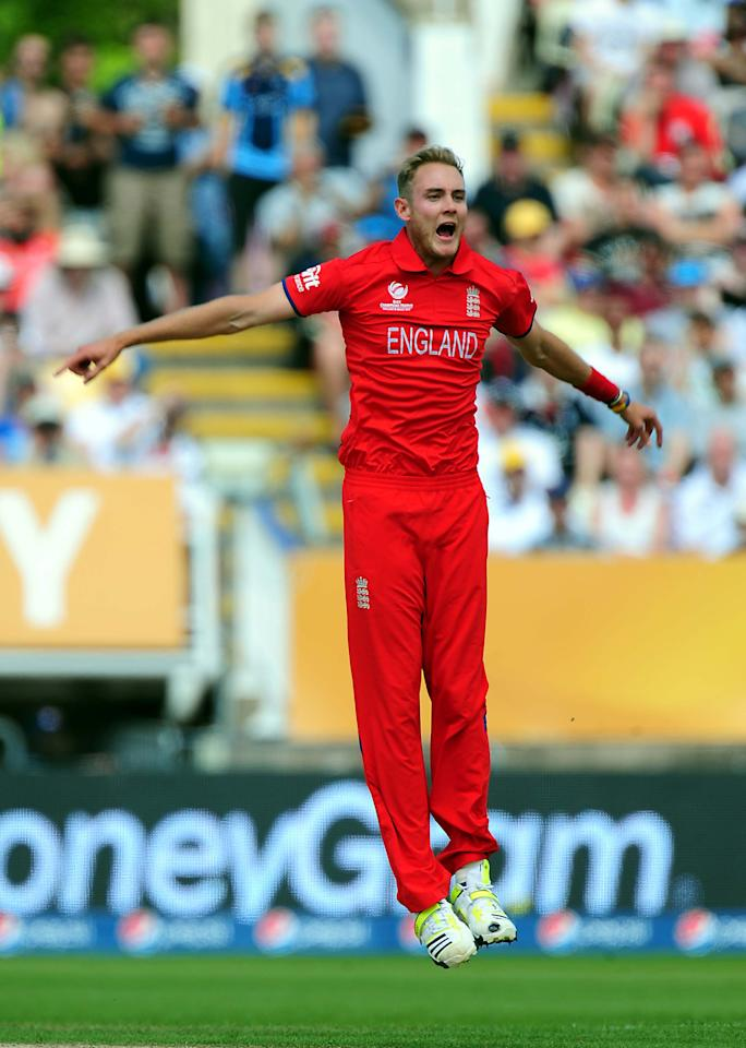 England's Stuart Broad celebrates after bowling Australia's David Warner caught Jos Buttler during the ICC Champions Trophy match at Edgbaston, Birmingham.