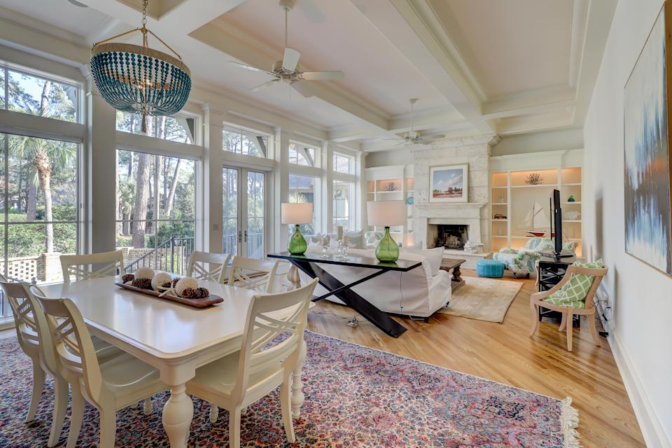 """With over 5,000 square feet and five bedrooms (each with their own ensuite bathroom), there's plenty of room for you to spread out at this Hilton Head home, located just four houses from the beach. Outside, you can enjoy the pool, hot tub, grilling area, fireplace with seating, and screened-in porch. Inside, you'll find an oversized modern kitchen with tons of prep space, three beachy living areas, two dining spaces, multiple work spaces for remote meetings, and a colorful bunk room with room for four. Bonus: You'll have access to the community pool and tennis courts, too. (<em>From 106,000 points per night)</em> $685, Marriott. <a href=""""https://homes-and-villas.marriott.com/en/properties/78121056-hilton-head-surf-scoter"""" rel=""""nofollow noopener"""" target=""""_blank"""" data-ylk=""""slk:Get it now!"""" class=""""link rapid-noclick-resp"""">Get it now!</a>"""