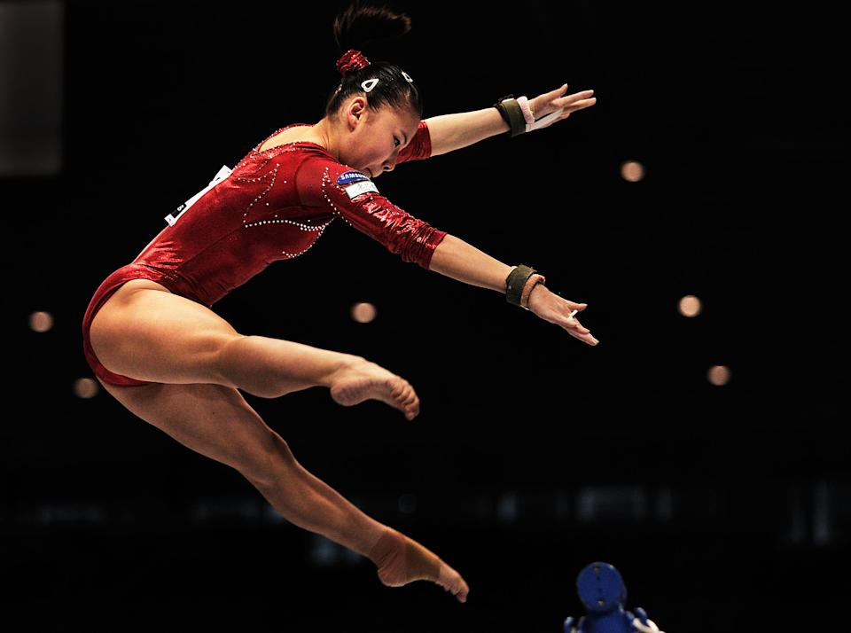 The disputed age of He Kexin was among a few controversies for 2008's Chinese Olympic gymnastics team. In 2012 Kexin will compete in the summer games once more whether she is 18 or 20 years old. (Adam Pretty/Getty Images)