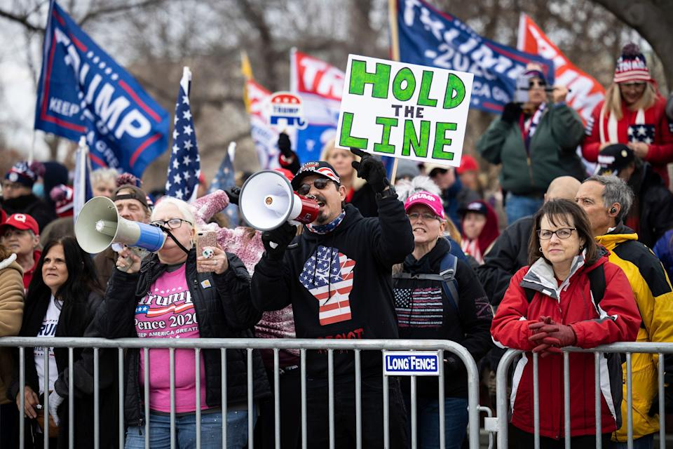 Supporters of President Donald Trump gather behind a police barricade on the east plaza of the U.S. Capitol onJan. 6 to protest the certification of President-elect Biden's Electoral College victory. (Photo: Francis Chung/E&E News and Politico via AP Images)