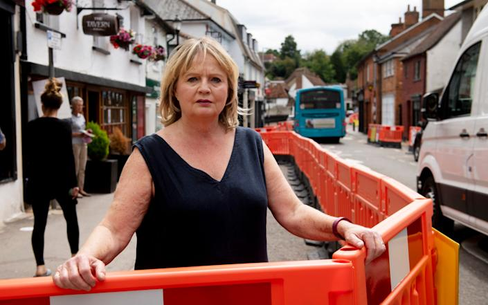 Jane Carr stands behind the barriers on Welwyn High Street - Geoff Pugh