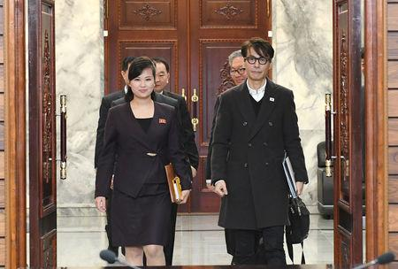 South Korean singer and chief delegate Yun Sang and Hyon Song Wol, head of the Samjiyon Orchestra, arrive for their meeting at the truce village of Panmunjom, North Korea, March 20, 2018.   The Unification Ministry/Yonhap via REUTERS