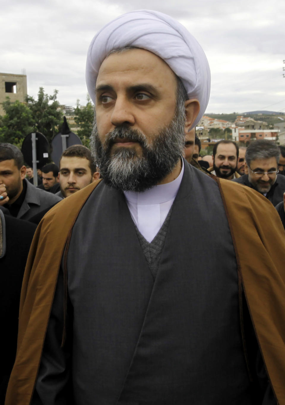 In this January 26, 2010, Sheik Nabil Qaouk a member of Hezbollah's Central Council, attends the funeral of prominent businessman Hassan Tajeddine in the southern village of Hanaway, Lebanon. On Friday, Oct. 23, 2020, the U.S. Treasury has sanctioned two high-ranking Hezbollah officials, Nabil Qaouk and Hassan al-Baghdadi, both members of Hezbollah's Central Council. The Council is responsible for electing members of the group's top decision-making body, the Shura Council. (AP Photo/Hussein Malla)