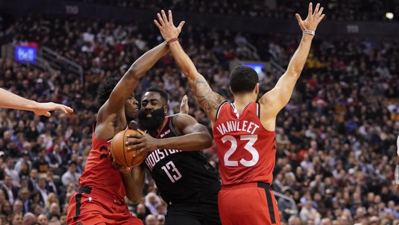 Dec 5, 2019; Toronto, Ontario, CAN; Houston Rockets guard James Harden (13) drives between Toronto Raptors forward OG Anunoby (3) and guard Fred VanVleet (23) during the first half at Scotiabank Arena. Mandatory Credit: John E. Sokolowski-USA TODAY Sports