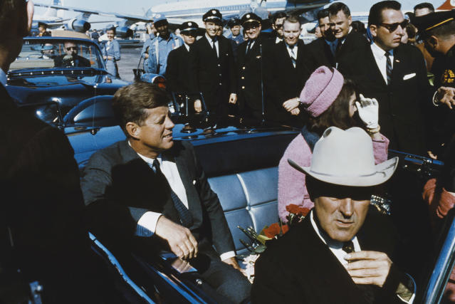 <p>President John F. Kennedy and first lady Jacqueline Kennedy sit in the back of an open-top limousine, along with Texas Gov. John Connally, forming a part of the presidential motorcade at Dallas Love Field airport, Nov. 22, 1963. (Photo: Rolls Press/Popperfoto/Getty Images) </p>
