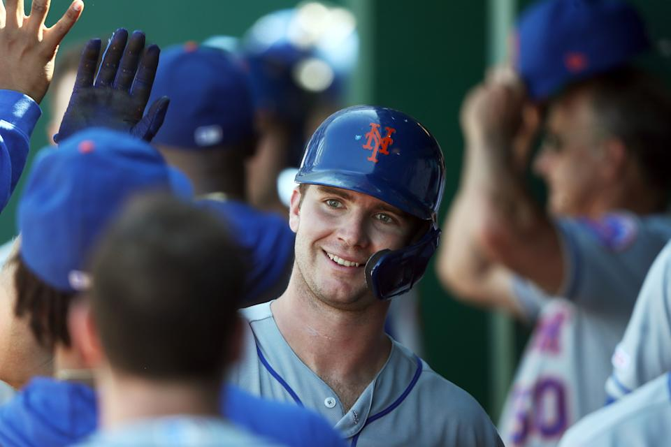 KANSAS CITY, MISSOURI - AUGUST 18:  Pete Alonso #20 of the New York Mets is congratulated by teammates in the dugout after hitting a home run during the 8th inning of the game against the Kansas City Royals at Kauffman Stadium on August 18, 2019 in Kansas City, Missouri. (Photo by Jamie Squire/Getty Images)