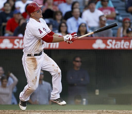 Los Angeles Angels' Mike Trout watches his home run against the Oakland Athletics during the seventh inning of a baseball game in Anaheim, Calif., Tuesday, May 15, 2012. (AP Photo/Chris Carlson)