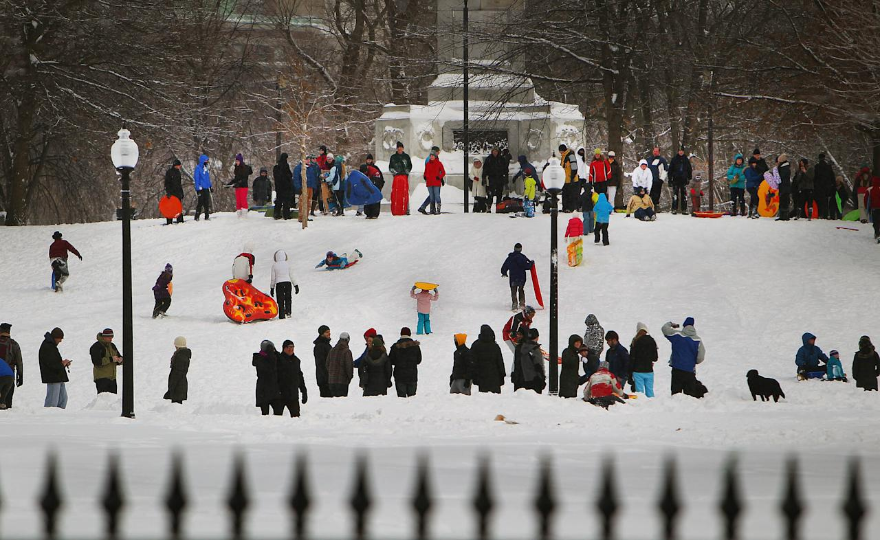 BOSTON - FEBRUARY 9: People begin to dig out from the big blizzard. Dozens sled on Boston Common. (Photo by John Tlumacki/The Boston Globe via Getty Images)