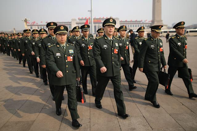 <p>Military delegates arrive for the second plenary session of the first session of the 13th National People's Congress (NPC) at the Great Hall of the People in Beijing on March 9, 2018. (Photo: Wu Hong/EPA-EFE/REX/Shutterstock) </p>