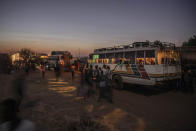 Tigray people who fled the conflict in Ethiopia's Tigray region, arrive on a bus at Umm Rakouba refugee camp in Qadarif, eastern Sudan, Thursday, Nov. 26, 2020. Ethiopia's prime minister said Thursday the army has been ordered to move on the embattled Tigray regional capital after his 72-hour ultimatum ended for Tigray leaders to surrender, and he warned the city's half-million residents to stay indoors and disarm. (AP Photo/Nariman El-Mofty)