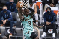 Charlotte Hornets guard Terry Rozier (3) drives to the basket while being guarded by Memphis Grizzlies center Gorgui Dieng during the first half of an NBA basketball game in Charlotte, N.C., Friday, Jan. 1, 2021. (AP Photo/Jacob Kupferman)